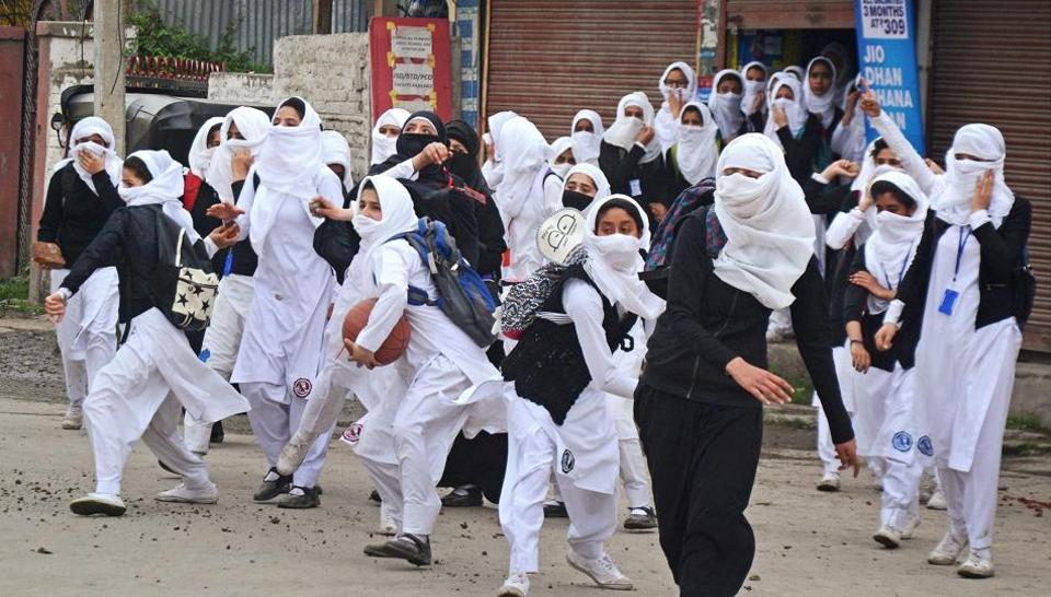 Girl students pelt stones at security personnel during clashes in the vicinity of Lal Chowk in Srinagar on April 24.
