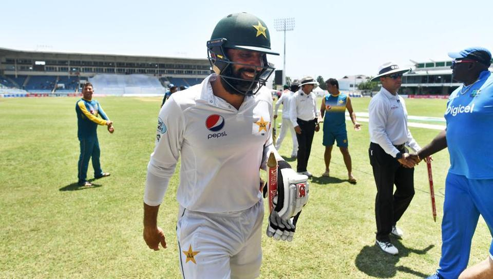 Pakistan's captain Misbah-ul-Haq smiles as he leaves the field after defeating West Indies on the final day of the first Test match at the Sabina Park in Kingston, Jamaica, on April 25, 2017.