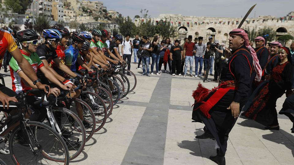 A group of cyclists have embarked on a multi-day tour in Jordan, Israel and the Palestinian territories as part of an effort to promote peace in the Middle East. (MENAHEM KAHANA / AFP)