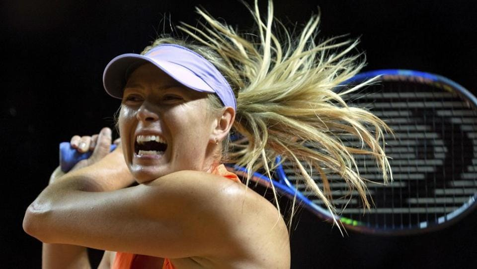 Maria Sharapova plays a return to Italy's Roberta Vinci during the Grand Prix tennis tournament in Stuttgart on Wednesday. Sharapova was given a lukewarm welcome by 4,500 spectators upon her return to professional tennis after a 15-month doping ban.