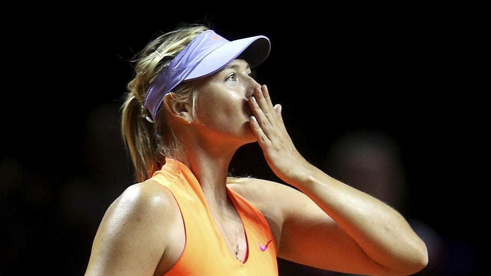 Maria Sharapova blows a kiss after winning 7-5, 6-3 against Roberta Vinci at the Porsche Tennis Grand Prix in Stuttgart, Germany on Wednesday. It was Sharapova's first match after a 15-month doping ban.