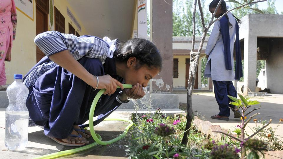 A student drinking water from a pipe at Government Middle School, Gurditpura, near Ludhiana on Wednesday.