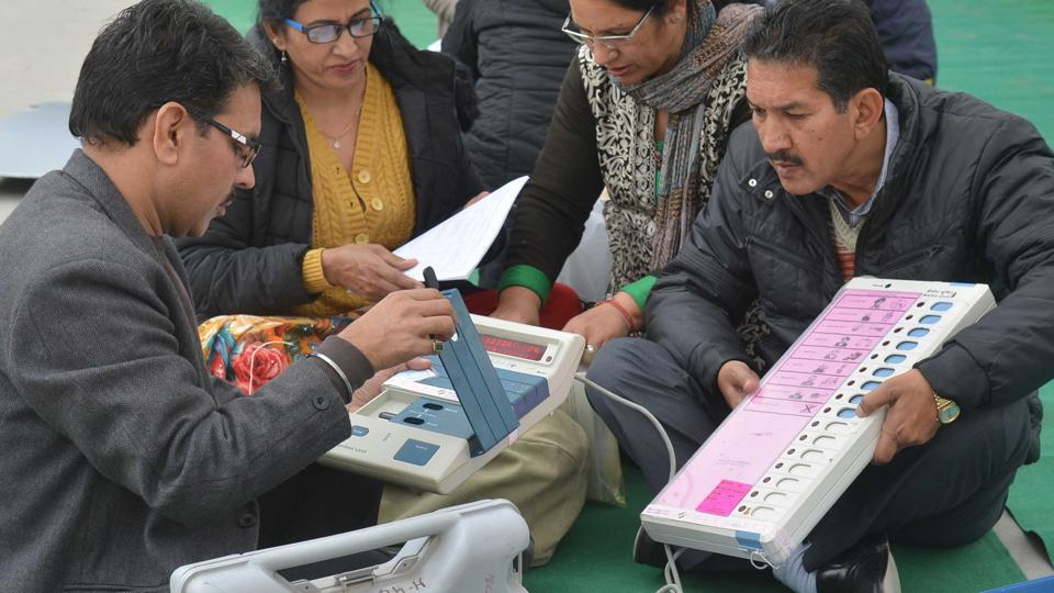 Indian election officials examine Electronic Voting Machines (EVM) from a distribution centre in Amritsar in this file photo from February 3, 2017. The poll panel will hold a hacking challenge in May, putting out EVMs that were used in the recent elections and some which will be used in the upcoming ones for the challenge.