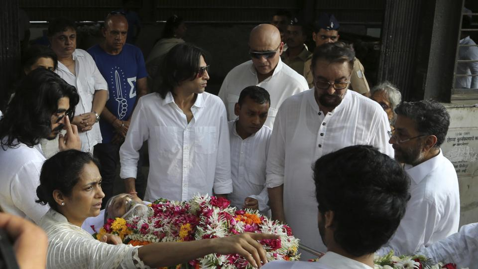 Friends and relatives carry the body of Vinod Khanna during his funeral in Mumbai.