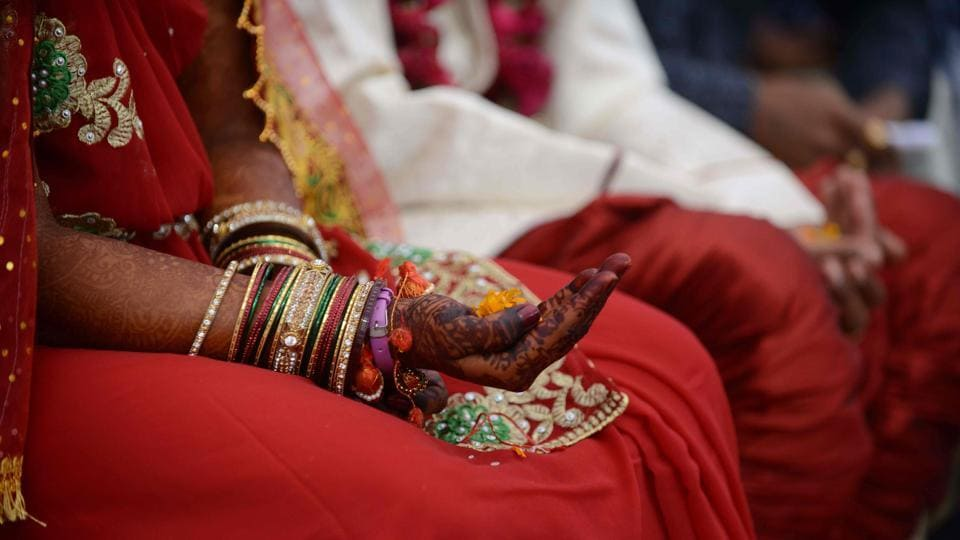 An Indian bride whose hands have been decorated with henna.
