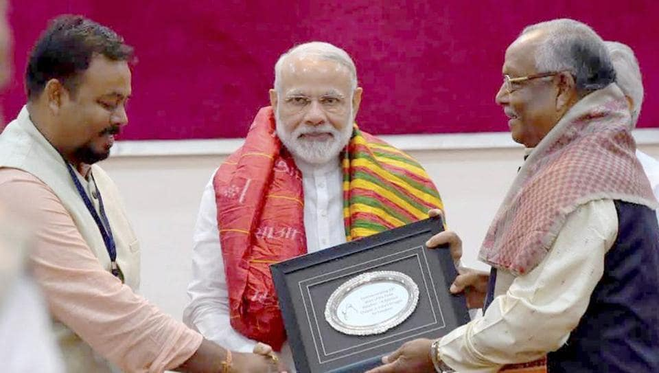 Prime Minister Narendra Modi felicitates the relatives of freedom fighters from Odisha, at a special programme, in Bhubaneswar on April 16.