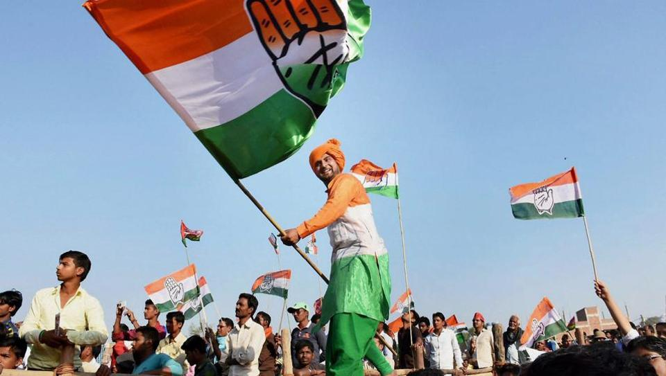 A Congress supporter waves a flag during a rally by party vice-president Rahul Gandhi ahead of the Uttar Pradesh polls held earlier this year.