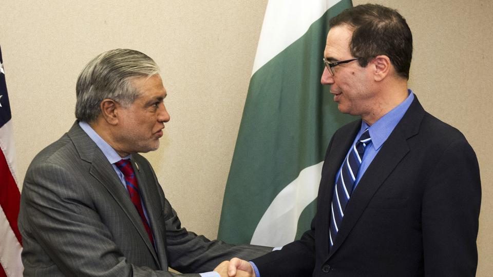 Treasury Secretary Steven Mnuchin, right, shake hands with Pakistan's Finance Minister Muhammad Ishaq Dar before a bilateral meeting during the World Bank/IMF Spring Meetings in Washington, Saturday, April 22, 2017.