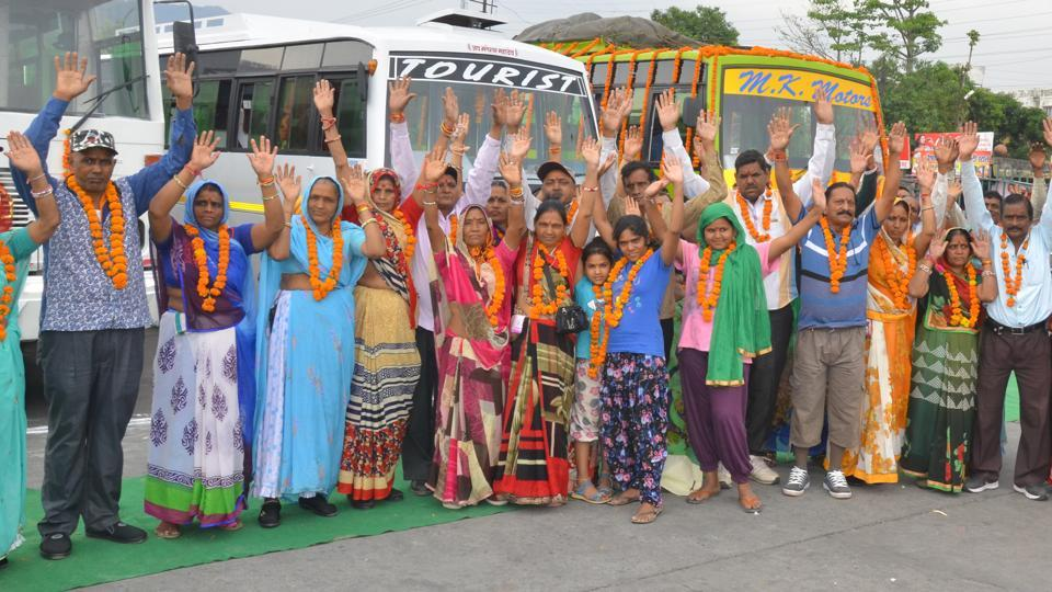 Pilgrims pose in front of buses during inauguration of the annual Chardham Yatra on Thursday in Rishikesh.