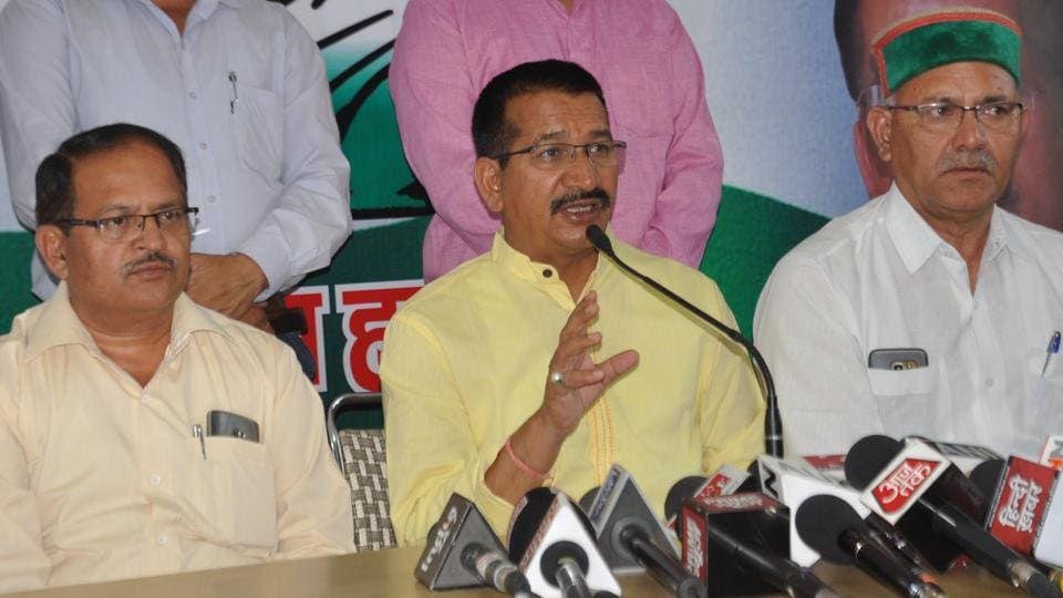 Congress state unit president Kishore Upadhyay (left) address the media in Dehradun on Thursday.