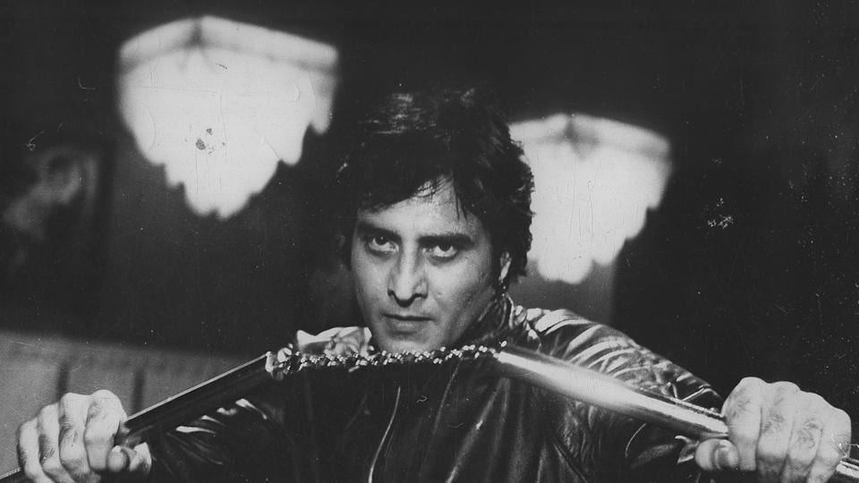 Vinod Khanna wielding some nunchucks in Insaaf. (HT Photo)