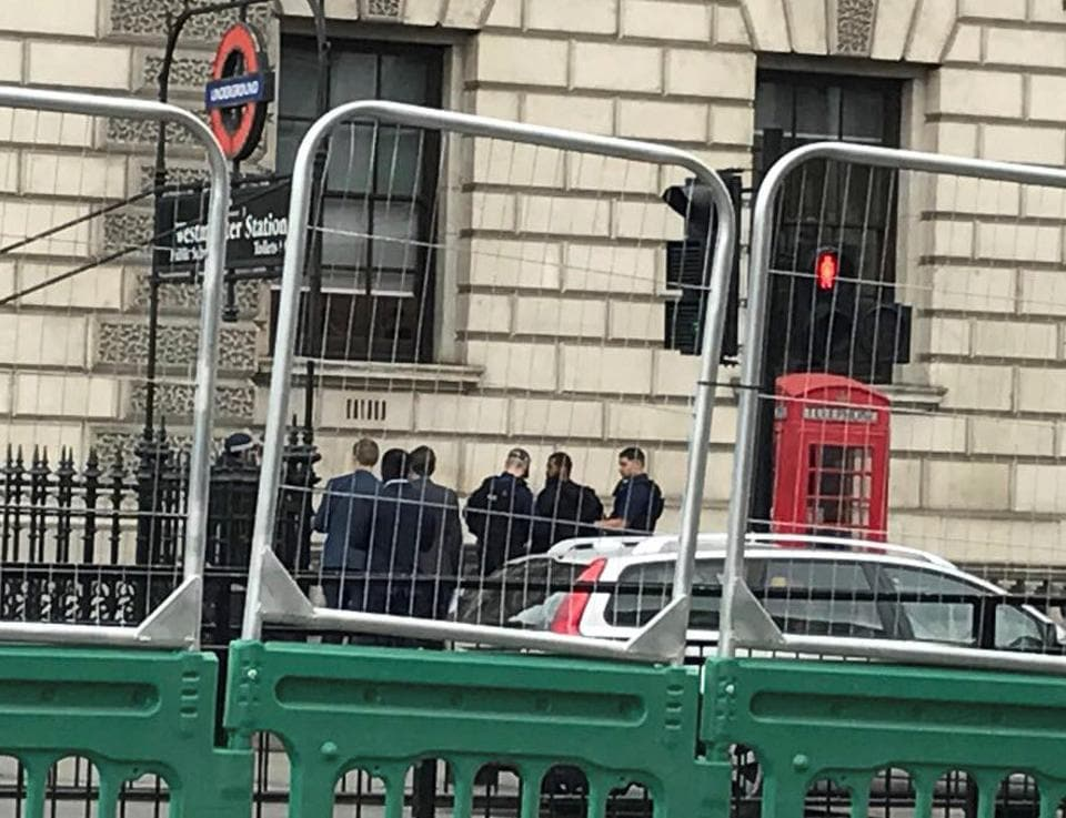 A man is held by police in Westminster after an arrest was made on Whitehall in central London on Thursday.