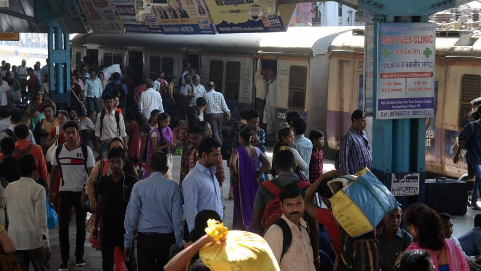 People at Kalyan station wait for trains to resume.