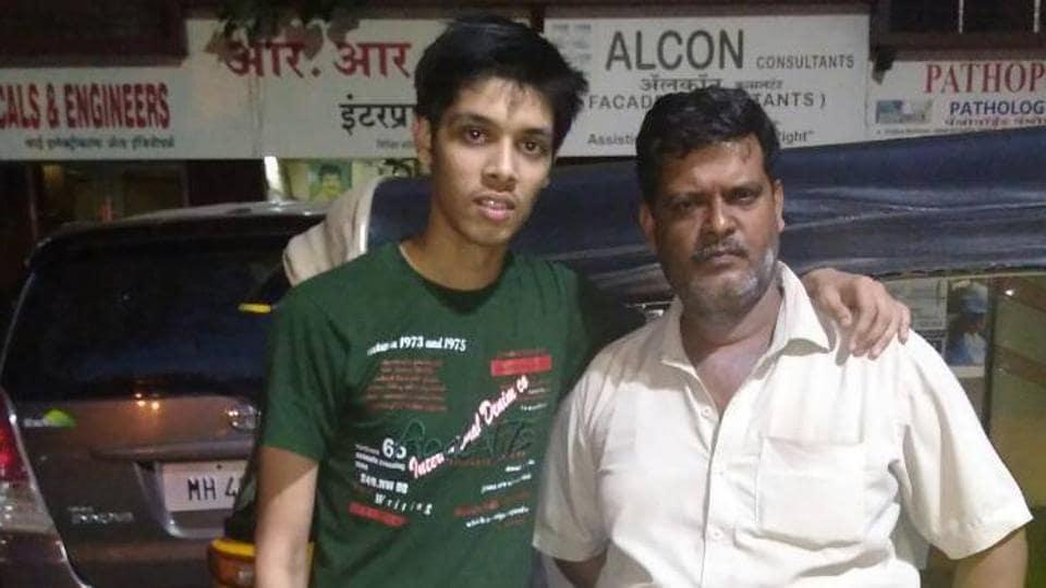 Dhananjay Tiwari poses with his father.
