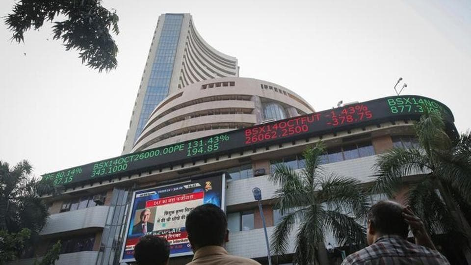Investors look at the indices outside Bombay Stock Exchange.