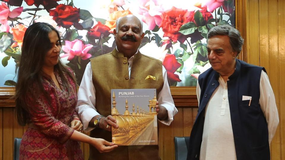 Punjab governor VP Singh Badnore releasing a book edited by Aabha Narain Lambah (left). Pakistani architect Nayyar Ali Dada (right) has authored a chapter on Lahore.