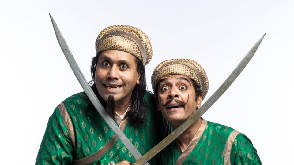 Actors Joy Fernandes (left) and Vrajesh Hirjee play palace guards in the play.