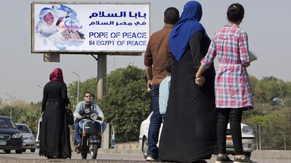 A billboard welcomes Pope Francis, in Cairo, Egypt on April 27, 2017. Last week a Vatican team arrived in Cairo to make preparations for the pope's security. Francis has chosen not to use a bulletproof vehicle to travel between engagements. (Amr Nabil/AP)