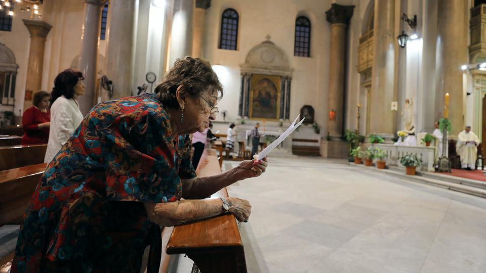 Christian woman prays at Saint Joseph's Roman Catholic Church before Pope Francis is scheduled to visit, in Cairo, Egypt . (Mohamed Abd El Ghany/REUTERS)