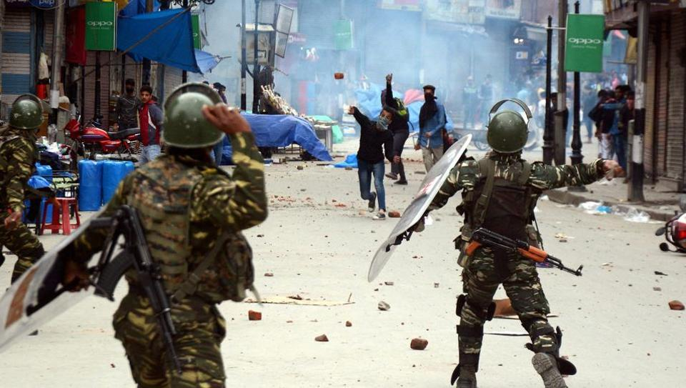 Security forces and protesters throwing stones on each other during clashes near Lal Chowk in Srinagar.