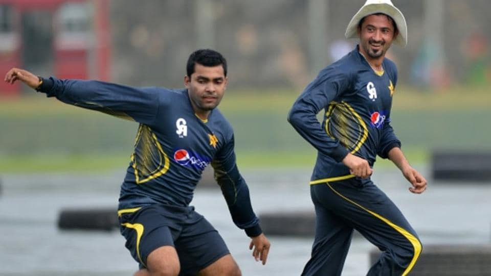 Pakistan cricketers Umar Akmal (left) and Junaid Khan
