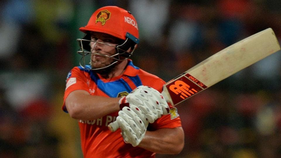 Gujarat Lions batsman Aaron Finch sends one to the boundary during the 2017 Indian Premier League (IPL) match against Royal Challengers Bangalore (RCB)at the M Chinnaswamy Stadium in Bangalore on Thursday.