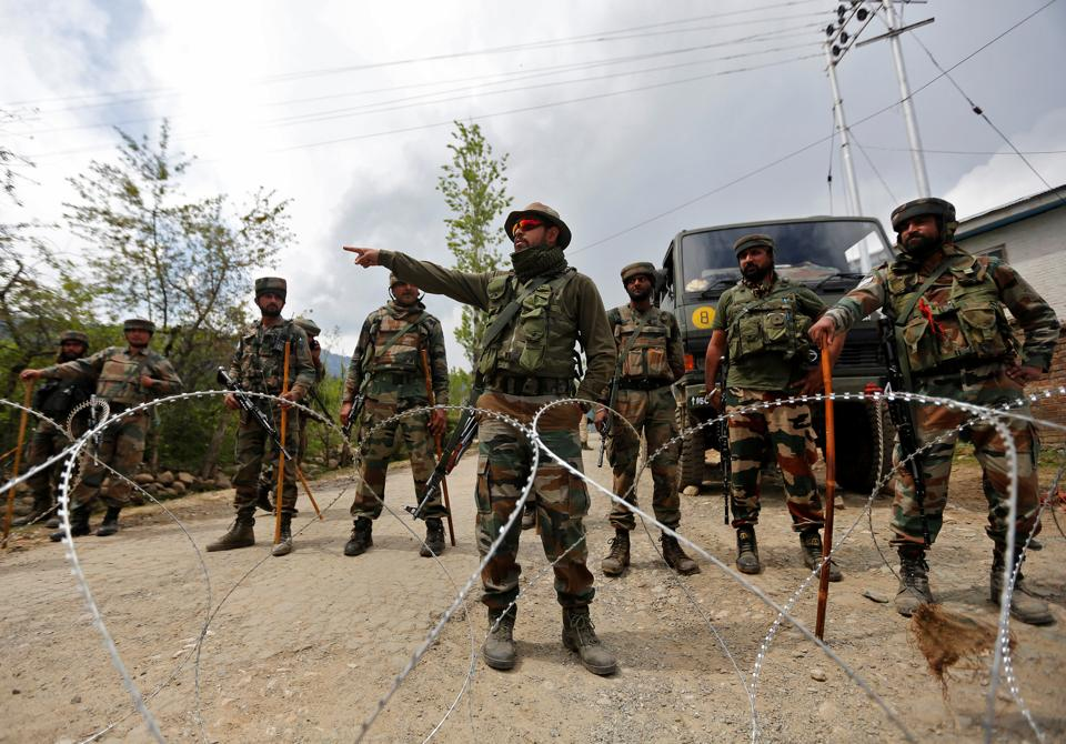 File photograph of soldiers outside a base in Kashmir's Kupwara district. l