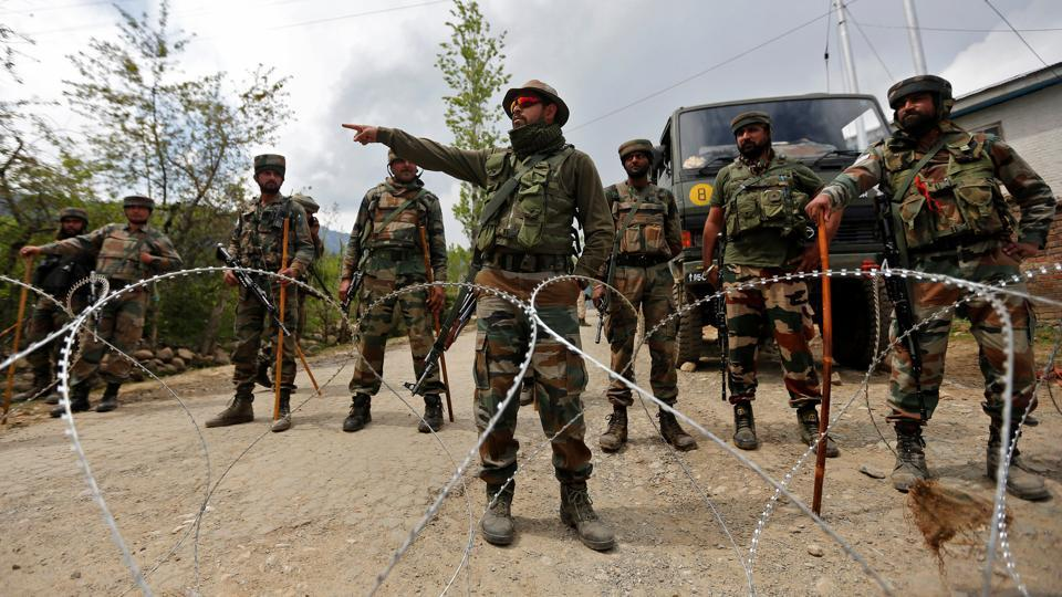 Indian army soldiers stand guard inside their army base after it was attacked by suspected separatist militants in Panzgam in Kashmir's Kupwara district.