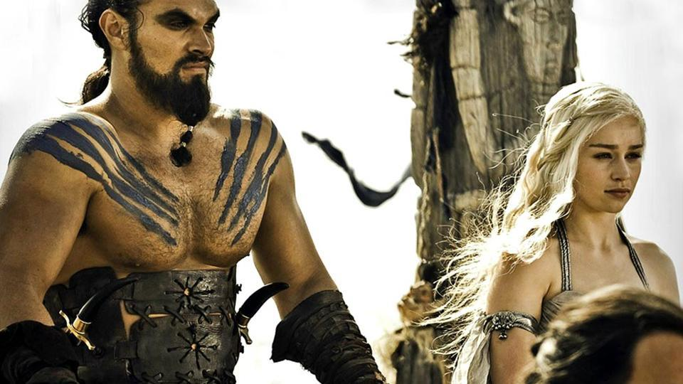 Jason Momoa and Emilia Clarke as Khal Drogo and Daenerys Targaryen in HBO's Game of Thrones.