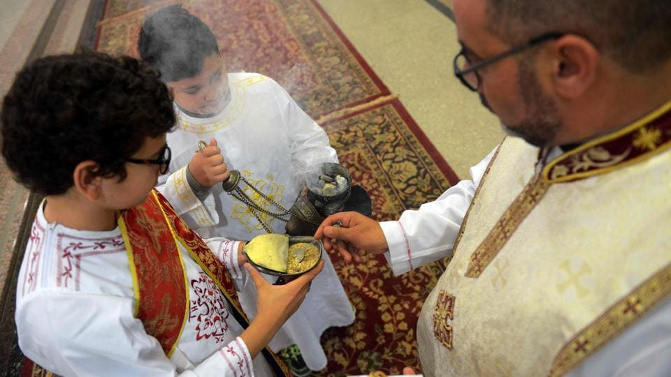 A priest burns incense during Sunday Mass at Saint Mary's church in the Egyptian capital Cairo on April 23, 2017, ahead of Pope Francis' visit.  (MOHAMED EL-SHAHED/AFP)