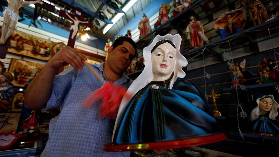 A man works inside a Christian souvenir shop ahead of Pope Francis' visit in Cairo. (Amr Abdallah Dalsh/REUTERS)