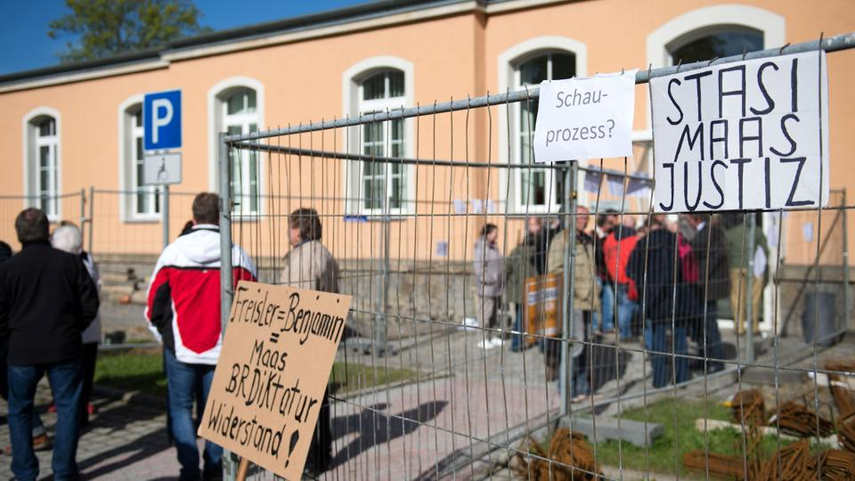 Demonstrators protest against the German government's asylum policy.