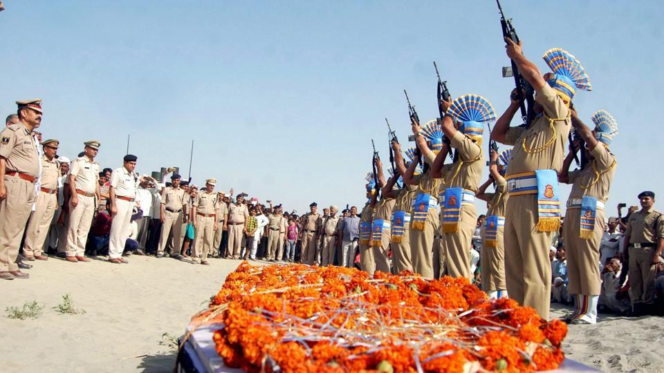 CRPF personnel give gun salute to a martyr during a funeral in Sonepat, Haryana.
