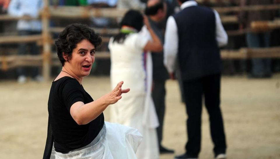 Priyanka Gandhi waves as she arrives at Congress a rally in Uttar Pradesh.