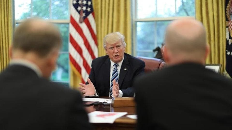 US President Donald Trump speaks during an interview with Reuters in the Oval Office of the White House in Washington, US.