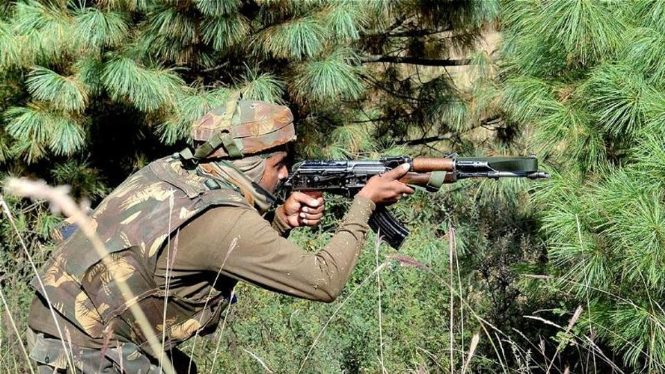 An army soldier taking position during an encounter with militants in Keran sector of Jammu and Kashmir.