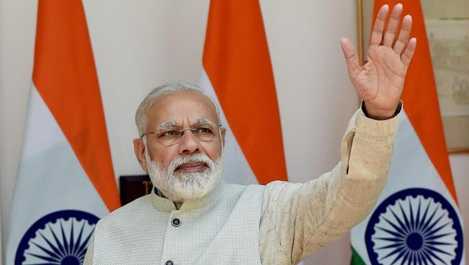 Prime Minister Narendra Modi greets the media in New Delhi on Wednesday. Karnataka, where the BJP came to power on its own for the first time in 2008, is the state from where the party is hoping to launch its battle for south India.
