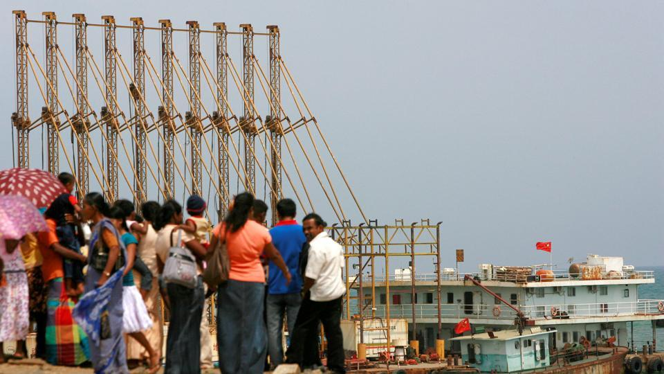 A group of Sri Lankan visitors at the new deep water shipping port watch Chinese dredging ships work in Hambantota, 240 km southeast of Colombo.