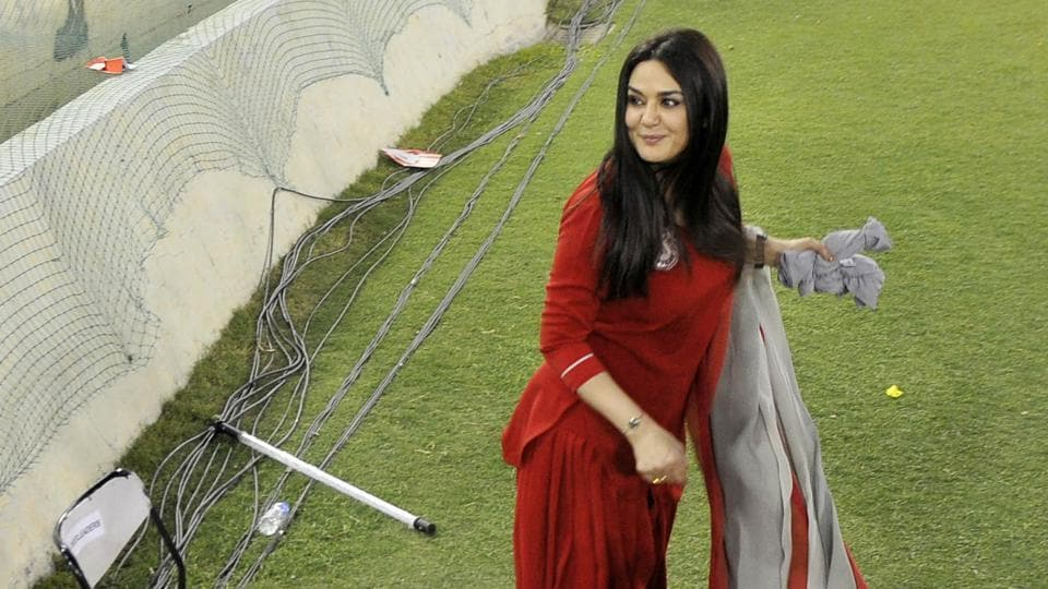 KXIP co-owner and cinestar Preity Zinta throws goodies to fans during the IPL match.  (Ravi Kumar/HT)