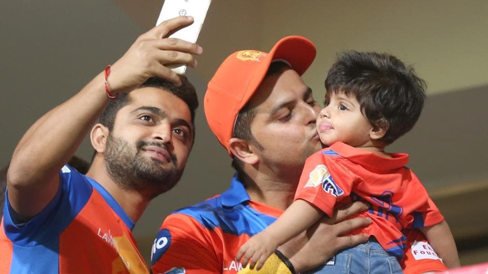 Suresh Raina with his daughter after Gujarat Lions defeated Royal Challengers Bangalore at the Chinnaswamy Stadium on Thursday.  Raina is the captain of Gujarat Lions