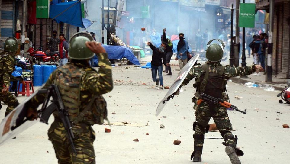 A clash between CRPF men and students at Srinagar's Lal Chowk on Monday. Kashmir has seen a spike in violence this month since eight people were killed during an assembly by-election in the city.