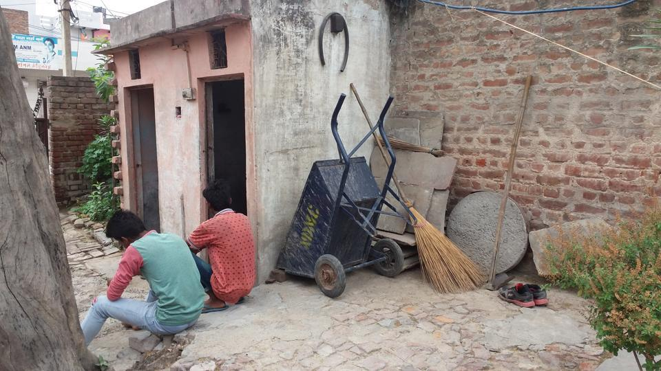 The two sons of the murdered woman in Kanjhawala on Saturday.