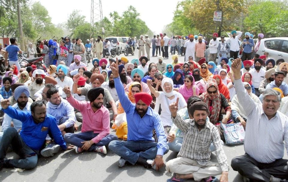 Teachers protesting at Khalsa College in Amritsar.