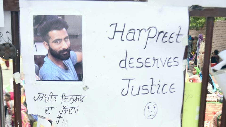 A banner at Khalsa College gates in Amritsar demands justice for the suicide victim.