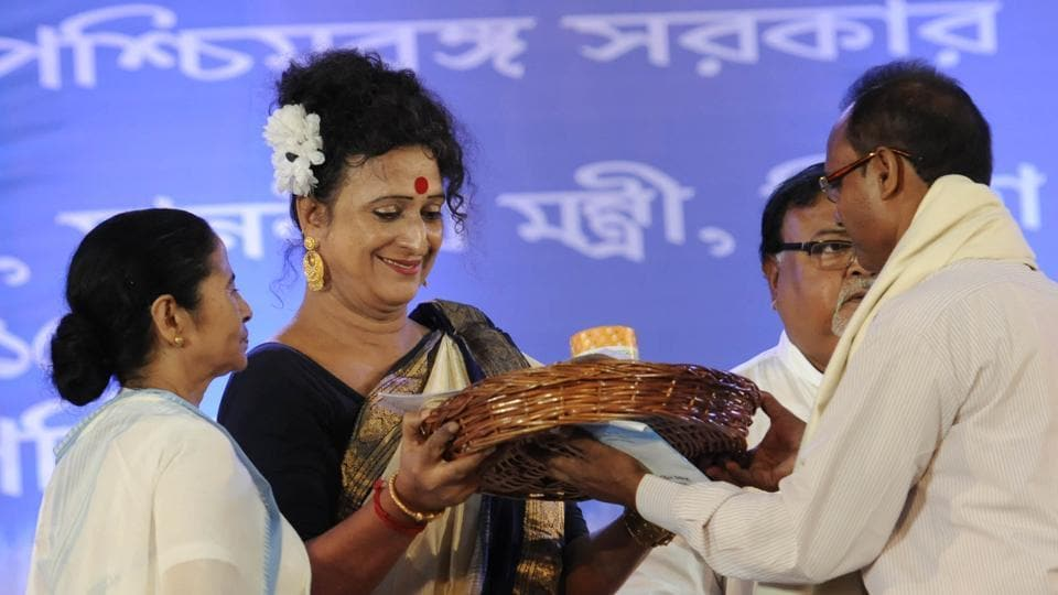 Teachers being felicitated by Manobi Bandyopadhyay (2nd from left), Principal of Krishnanagar Women's College, in the presence of Chief Minister Mamata Banerjee and Education Minister Partha Chatterjee, on the eve of Teacher's Day on September 4th, 2015, at Nazrul Mancha, in South Kolkata.