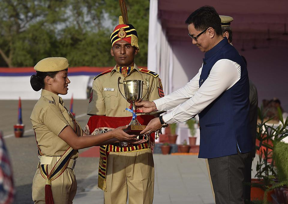 Rijiju giving away the best all-round trophy to C. Thele. The Passing out Parade of 107th (Male) and 108th (Female) batches of Recruit Constables was held at Police Training College, Jharoda Kalan. The parade was attended by Union Minister of State for Home Affairs Kiren Rijiju. (Raj K Raj/HT PHOTO)