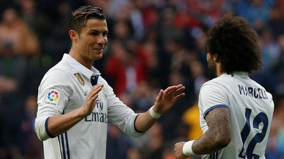 Cristiano Ronaldo and Marcelo scored for Real Madrid C.F. as they defeated Valencia 2-1 to climb back on top of the La Liga table.