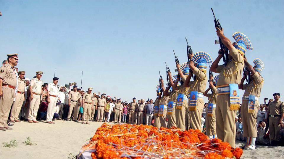 CRPF personnel give gun salute to a soldier killed in a Maoist attack in Chhattisgarh's Sukma, in Harayana's Sonipat.