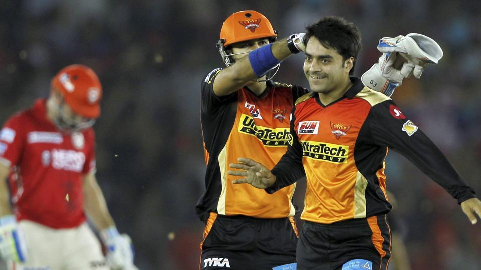 Sunrisers Hyderabad's (SRH) Rashid Khan (right) celebrates the wicket of Eoin Morgan of Kings XI Punjab during their Indian Premier League (IPL) match in Mohali on Friday.