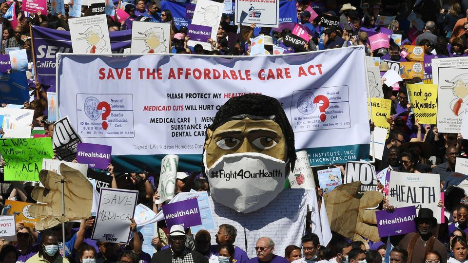 (FILES) Protesters dressed as medical staff march towards the Federal Building during a 'Save the Affordable Care Act' rally in Los Angeles, California on March 23, 2017. (AFP)